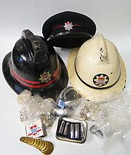 Two Old Fireman's Helmets, cap with London badge and box of oddments
