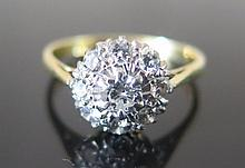 A Diamond Cluster Ring in 18ct gold setting, size M.5, 2.7 g