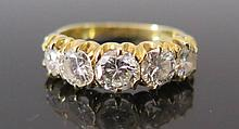 A Diamond Five Stone Ring in 18ct yellow gold setting, size N, 4.1 g