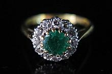An Emerald and Diamond Cluster Ring in 18ct yellow gold setting, size L.5,