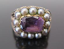 A Georgian Amethyst and Seed Pearl Ring in an precious yellow metal setting