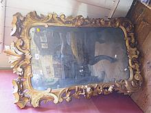 A Nineteenth Century Carved Gilt Gesso Rococo Style Wall Mirror, 105 x 63 c
