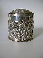 A Victorian Silver Casket decorated with putti and
