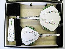 An Art Deco Floral Guilloche Enamel Hand Mirror