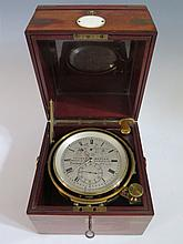 A Thomas Mercer Marine Chronometer with chain driven fusee movement and in original mahogany and brass mounted case
