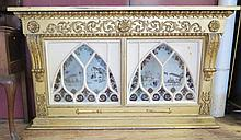 A Nineteenth Century Carved Gilt wood Overmantle Mirror with plates replaced by old chinoiserie stained glass back lit panels