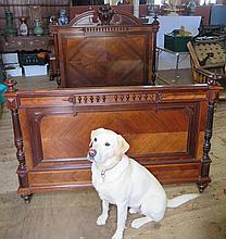 A Nineteenth Century French Rosewood 4ft 6 in Double Bed with a carved headboard
