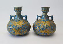 A Pair of Crown Derby Turquoise Ground Two handled Vases with gilt foo dog and foliate decoration