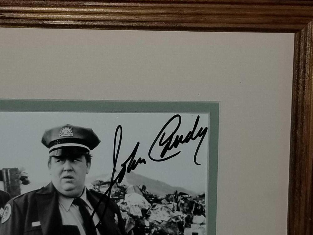 Lot 11: JOHN CANDY AUTOGRAPHED FRAMED & MATTED PHOTO