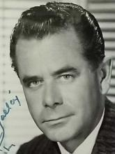 Lot 39: GLENN FORD BLACK & WHITE PUBLICITY PHOTO FRAMED