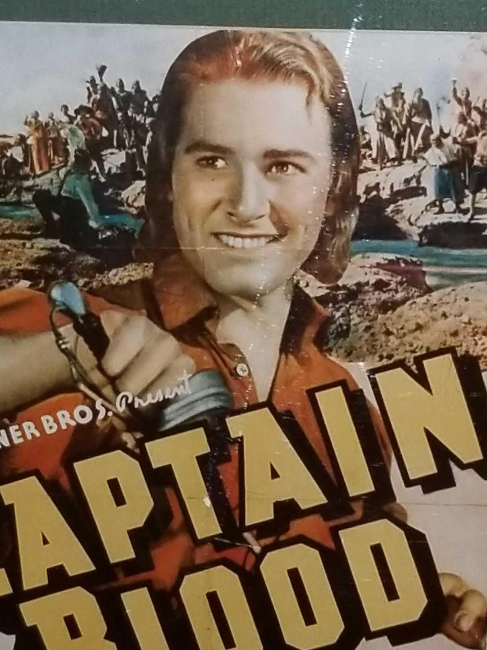 "Lot 54: ERROL FLYNN REPRODUCTION ""CAPTAIN BLOOD"" MOVIE POSTER W/ AUTOGRAPH CARD"