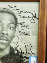 Lot 63: EDDIE MURPHY BLACK & WHITE SIGNED PHOTO
