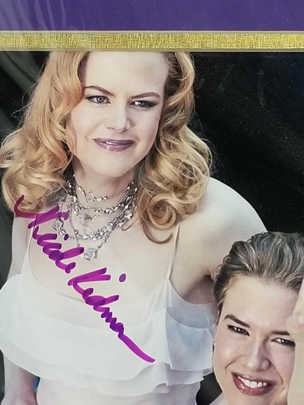 Lot 127: NICOLE KIDMAN & RENEE ZELLWEGER DOUBLE SIGNED COLOR EVENT PHOTO W/ LETTER OF GUARANTEE