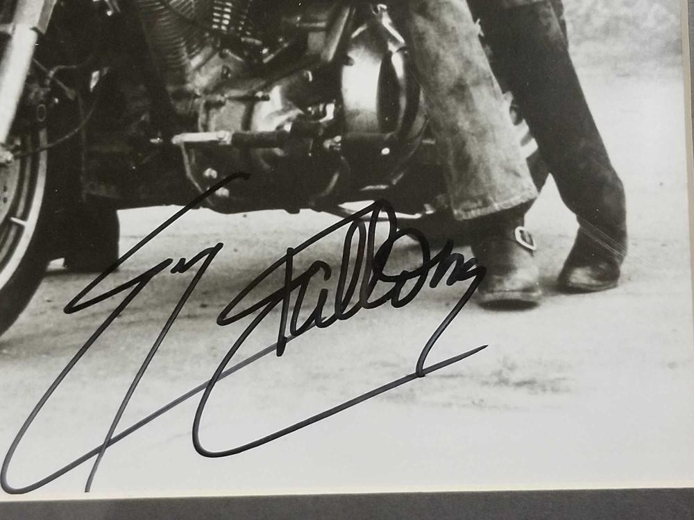 Lot 157: SLY STALLONE BLACK & WHITE SIGNED PUBLICITY PHOTO