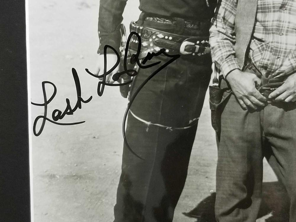 "Lot 153: LASH LA RUE"" SIGNED BLACK & WHITE PHOTO W/6 MINIATURE REPRODUCTION LOBBY CARDS"