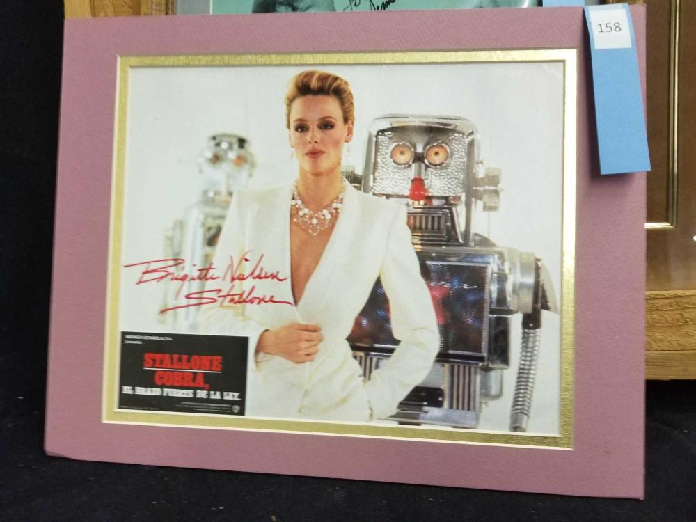 BRIGITTE NIELSEN STALLONE COLOR SIGNED SPANISH MOVIE POSTER
