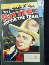 """Lot 167: TEX RITTER REPRODUCTION """"HITTIN' THE TRAIL""""COLOR MOVIE POSTER W/ SIGNATURE CARD"""