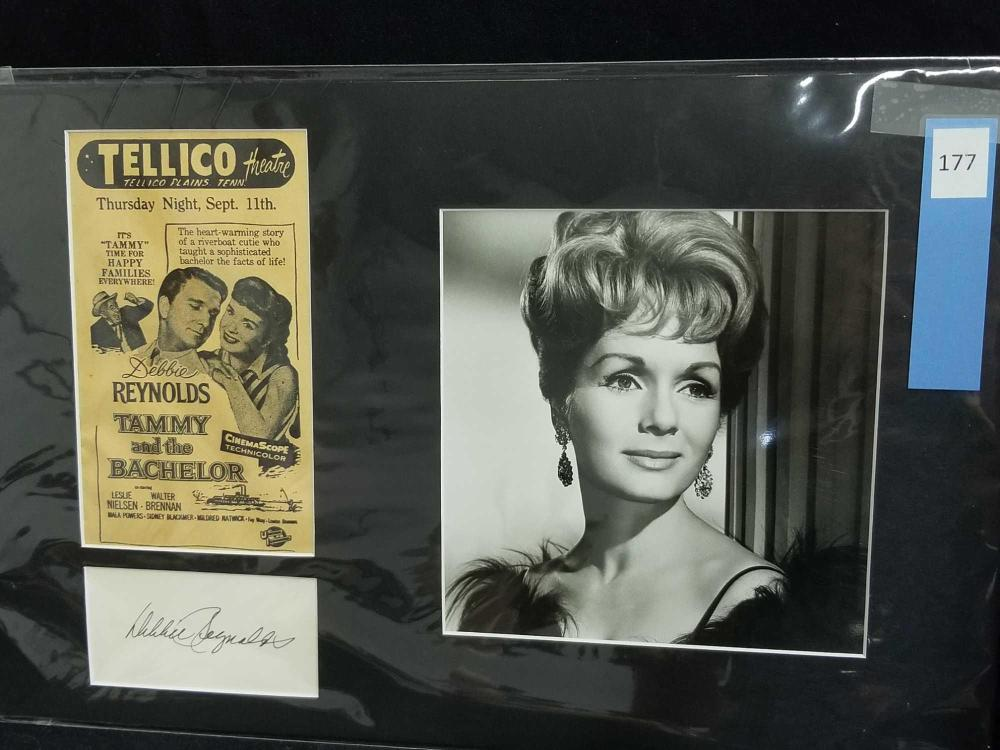 Lot 177: DEBBIE REYNOLDS BLACK & WHITE PUBLICITY PHOTO W/ REPRODUCTION MOVIE ADVERTISING & SIGNATURE CARD