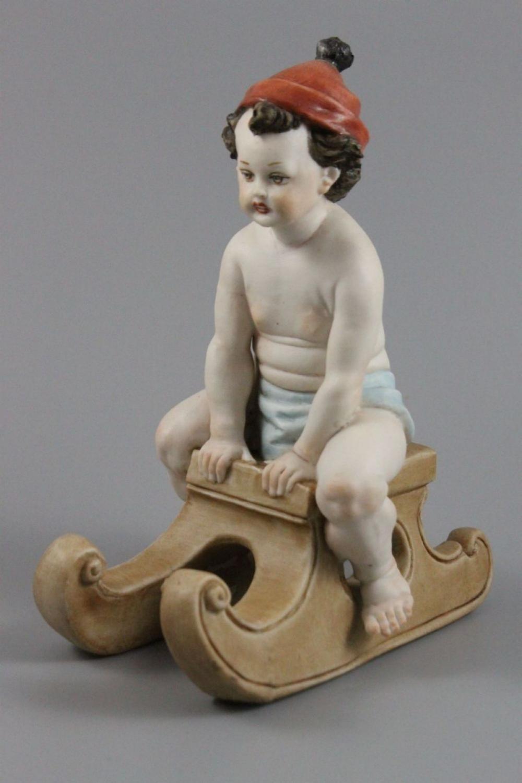 Capodimonte Tiche Tosca Figurine Boy on Sledge