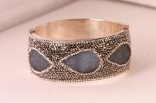 Stunning large high fashion bangle bracelet.