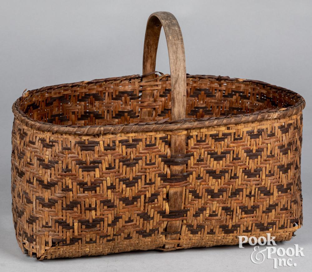 Woodlands Indian woven handle basket
