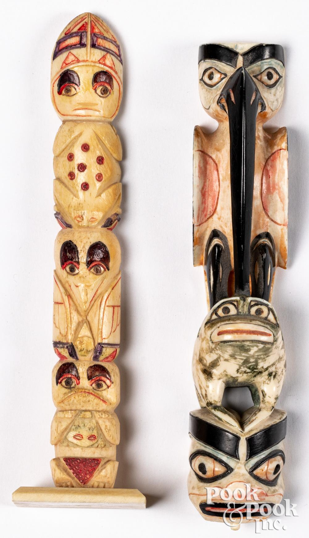 Two Pacific Northwest Coast Indian totem poles