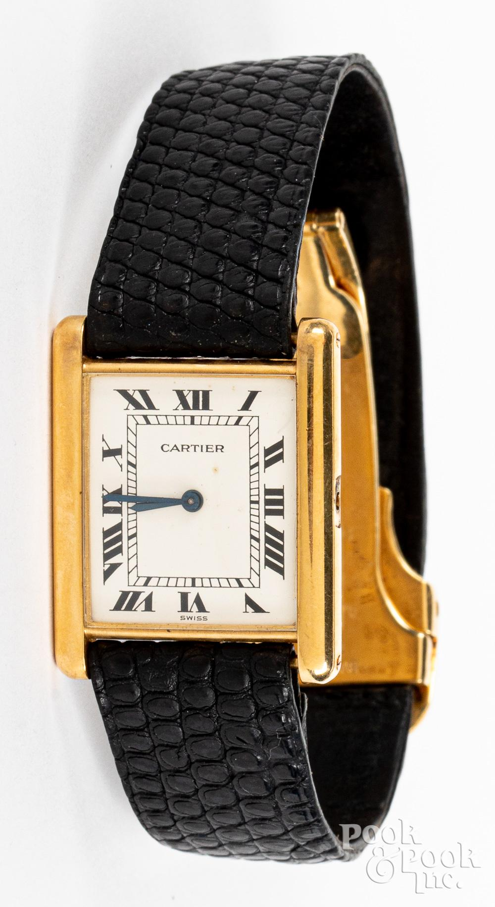 Cartier 18K gold wristwatch with a Bulgari clasp.