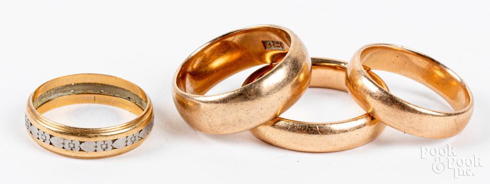 Four 14K gold bands, 14.7dwt.
