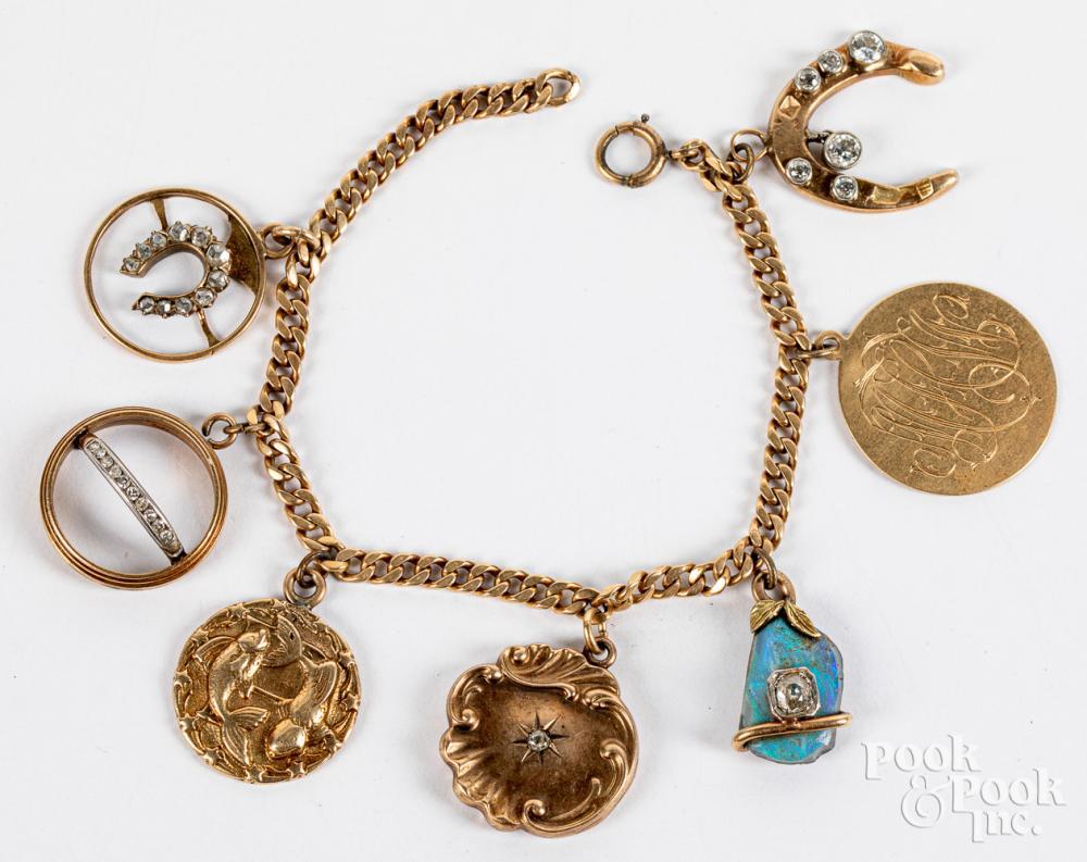 14K gold charm bracelet, 30.2dwt.