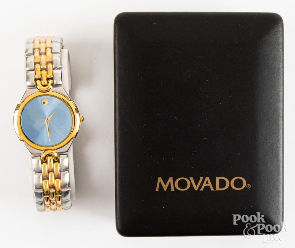 Movado wristwatch in box.