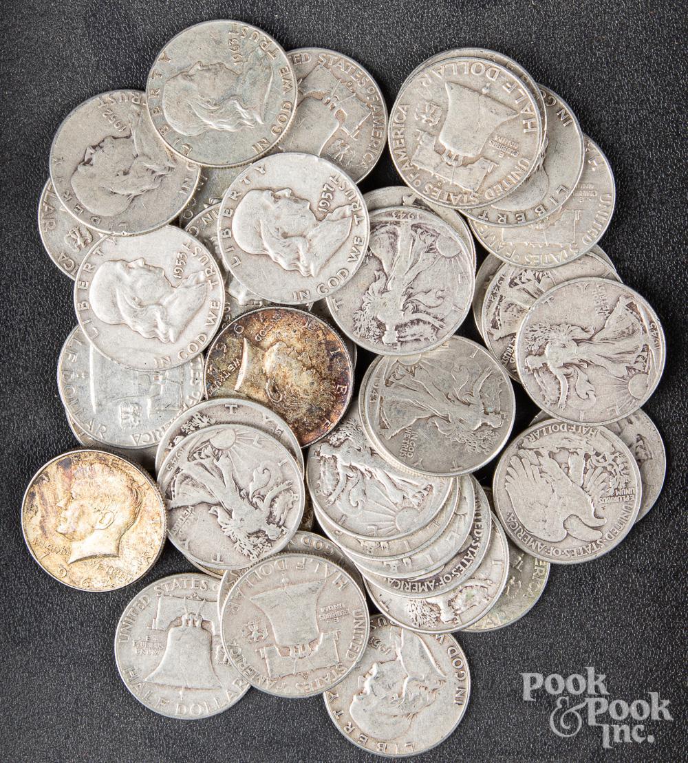 Forty-three silver half dollars.