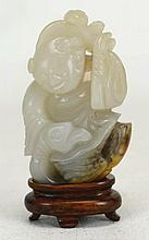 Chinese Carved Jade Figure Of Man On Serpant