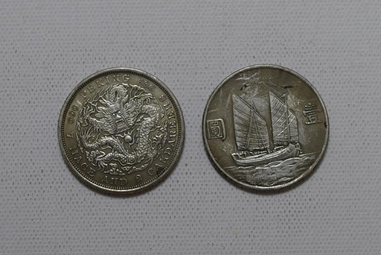 TWO CHINESE SILVER DOLLAR COINS