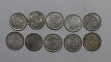 TEN CHINESE SILVER 20 CENT COINS