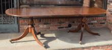 Duncan Phyfe Style Dining Table.  Mahogany with reeded sides and legs, brass feet with casters, one leaf.
