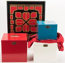 """Banner Nest of Boxes. Alhambra: Owen Magic, ca. 1965. The smallest box from a nest of three – with a dove inside – vanishes, only to be found back inside the other two. The missing bird is inside. Cloth, tray, boxes and instructions. Largest box 11 x 8 ½ x 8"""". Tray with classic Owen paint scheme."""