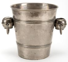 Coin Pail. Hamburg: Janos Bartl, ca. 1925. Metal champagne bucket outfitted with two Kellar-style droppers in its handles (which push coins inside the pail), and five droppers underneath which release large stacks of coins individually. 7 ½? high.