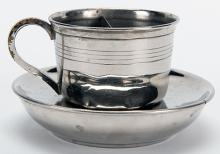 Confetti Cup. Paris: A. Mayette [?], ca. 1940. Handsome metal cup and saucer that transforms coffee or water into dry confetti. Finely crafted from nickel-plated brass. Very good.