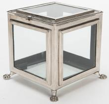 Crystal Casket. German [?], ca. 1910. Nickel-plated box resting on four claw feet is shown empty, yet instantly fills with a quantity of silk handkerchiefs. 5