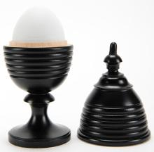 Egg Vase. Lake Forest, Ill.: John McKinven, ca. 1990. An egg is removed from a wooden vase then magically reappears inside. Finely hand-turned ebonized hardwood with faux white wooden egg. 6 ½? tall. Fine. Hallmarked.