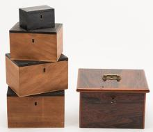 Nest of Boxes. European, ca. 1910 [?]. Handsome set of five nesting wooden boxes. A borrowed object vanishes, then reappears in the smallest of the nested boxes. The outer box of finely finished hardwood. The inner four boxes with sham locks; the outer with attractive brass hardware and original key. Working not apparent. The largest 8 x 7 x 5?.