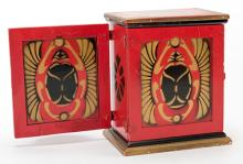 One-Hand Production Box. Los Angeles: F.G. Thayer, ca. 1930s. A quantity of handkerchiefs is produced from the box a moment after it was shown empty. Finely stencil-painted scarab beetle design with metal fixtures. 6 ½ x 5 ½ x 3 ¾?. Very good.