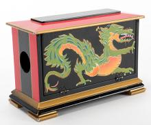 Silk Cabby. Tampa: Hamilton, ca. 1960. A multi-color wooden cabinet from which handkerchiefs disappear or change, with dragon designs on side panels. 7 ½ x 3 ½ x 5?. Roof nicely repainted. Hallmarked.