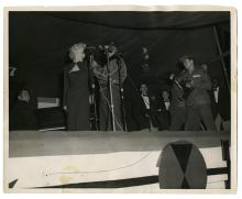 Photo of Marilyn Monroe on Stage with U.S. Soldiers in Korea.