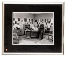 A Vintage Photograph of Walt Disney in His Office.