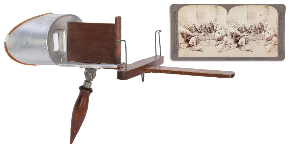 [STEREOVIEWS]. PAIR OF STEREOVIEWERS WITH A LARGE GROUP OF ...