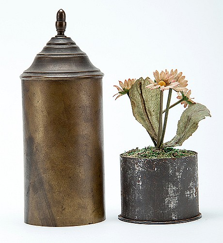 Birth of Flowers. Manufacturer unknown, ca. 1880s. A miniature pot sewn with a few seeds is suddenly filled with daisies after it has been covered by a brass tube. 6î x 2 _î. Age-consistent tarnish, else good. A comparable piece of apparatus is