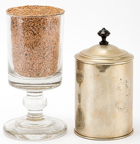 Bran and Candy Glass. Circa 1915. A crystal goblet filled with bran is covered momentarily by a brass lid. When lifted, the bran has transformed into pieces of candy. Heavy glass, tin gimmick. 7 _î high.