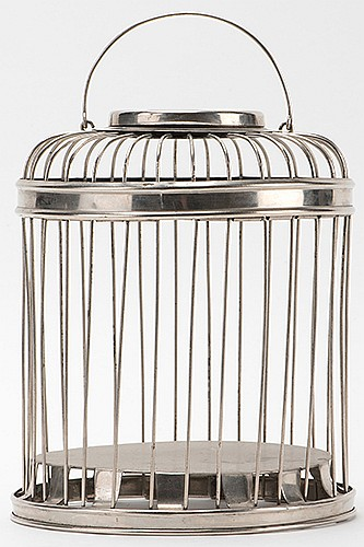Production Cage. German [?], ca. 1920. Round metal cage collapses into a small space and can be produced from a handkerchief. Accommodates two or three small birds. 7î high.