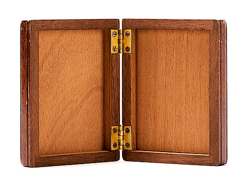 Lock Flap Card Box. Los Angeles: F.G. Thayer, ca. 1935. Handsome mahogany box changes, produces or vanishes cards, bills, or billets of paper placed inside. Locking gimmick designed by Carl Owen. Holds poker size cards. Minor wear to finish. Very